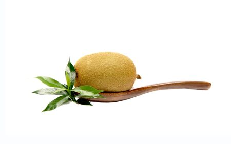ladle: Kiwi fruit on ladle