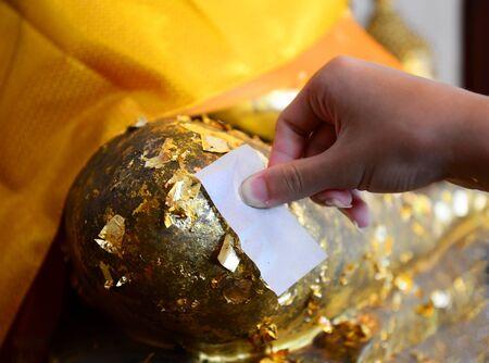 the gilding: Gilding Buddha the Gold Leaf On Buddha Statue