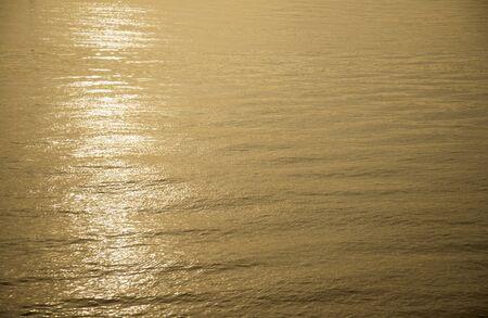 glare: Background photo, sun glare on dark sea water with wave pattern, select focus