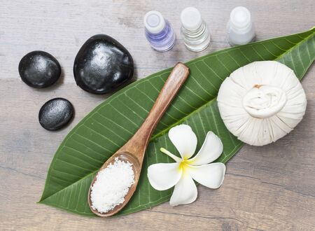 revitalize: Spa massage compress balls, herbal ball on the leaves with rock spa, Thailand, select focus Stock Photo