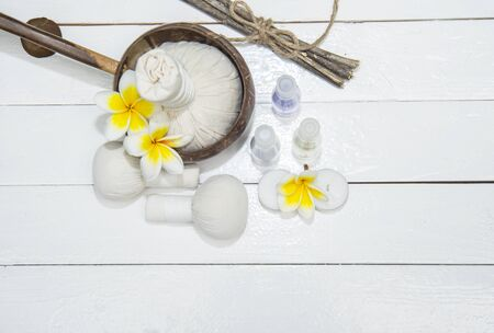 revitalize: Spa Treatments  and massage on wooden white