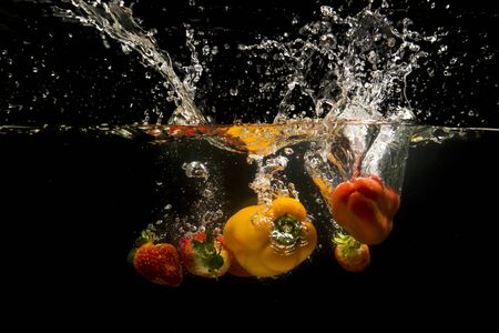 dropped: Photo of a vegetables dropped under water