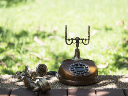 Retro and vintage telephone on blurry background, select focus