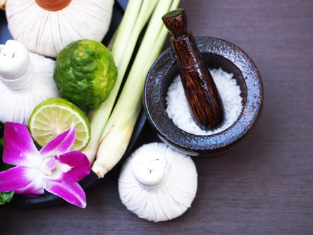 Natural Spa Ingredients herbal compress ball and herbal Ingredients for alternative medicine and relaxation Thai Spa theme with silk fabric, Thailand, select focus Stock Photo