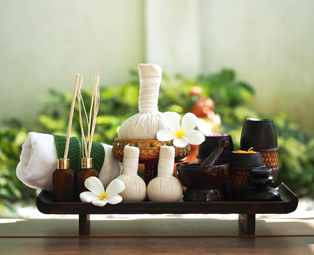 rejuvenate: Spa massage compress balls, herbal ball on the wooden with treaments spa , Thailand, select focus