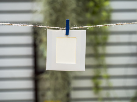 instant film transfer: Photo Frames on Rope. background the nature, soft focus Stock Photo