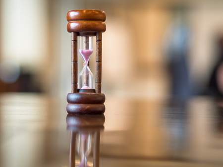 seconds: Closeup wooden hourglass on the table, soft and select focus