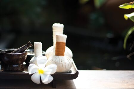 compress: Spa Treatments and massage on wooden white, select and soft focus
