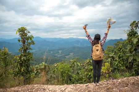 Hiker woman feeling victorious facing on the mountain, Thailand Reklamní fotografie