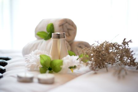 compress: Spa treatment and product and relax spa with the bed and white flowers , Thailand. Greenery tone 2017, select focus