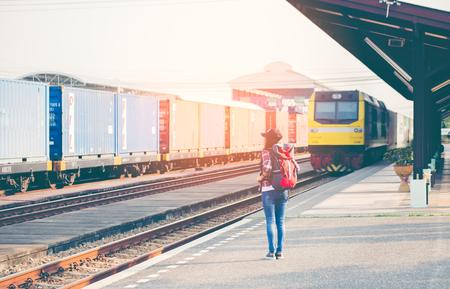 travler: Travler women walking alone Carrying luggage and waits train on railway station
