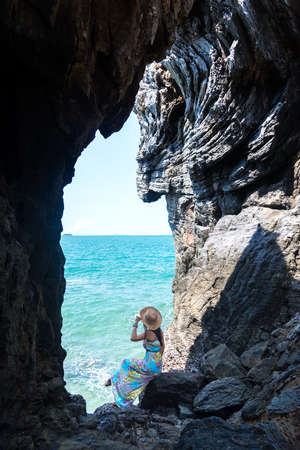 phra nang: Travel women in a cave near the sea in Keo Sichang, Thailand
