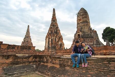 Traveler man and women with backpack walking in temple Ayuttaya ,Thailand, soft and select focus