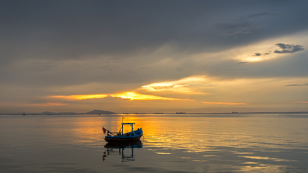 Fish boat with sunset at the seashore and beautiful sky, Bangpha, Thailand