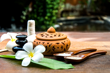 Thai Spa massage compress balls, herbal ball and treatment  spa with flower, Thailand.  Healthy Concept. select focus Zdjęcie Seryjne