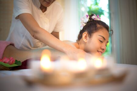 Masseur doing massage spa with treatment on Asian woman body in the Thai spa lifestyle, so relax and luxury.  Healthy Concept