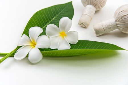 Thai Spa massage compress balls, herbal ball and treatment  spa, relax and healthy care with white flower, Thailand.  Healthy Concept. select focus