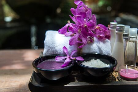 Thai Spa Treatments aroma therapy  salt and sugar scrub and rock massage with orchid flower.  Healthy Concept. copy space,select and soft focus