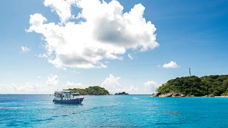 Beautiful sea with travel boats at Tachai island, Phang nga, Thailand.  Blue sky background