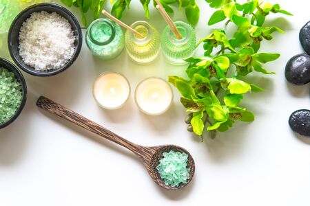 compress: Thai Spa Treatments aroma therapy  salt and nature green sugar scrub and rock massage with green orchid flower on wooden white with candle. Thailand.  Healthy Concept. copy space,select and soft focus Stock Photo
