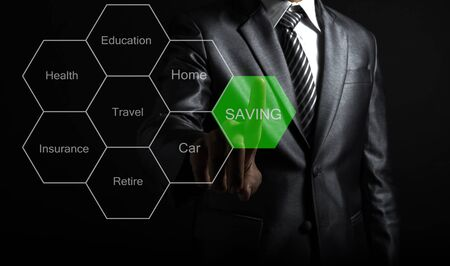 Businessman touching concept Saving money for the future life.  Saving Concept Stock Photo