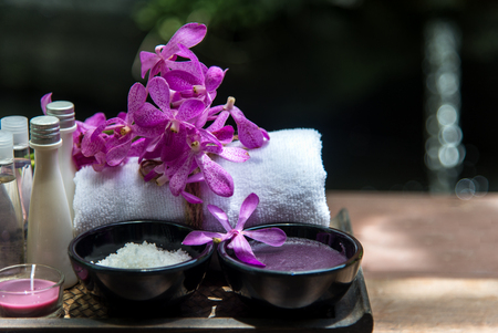 Thai Spa Treatments aroma therapy  salt and sugar scrub and rock massage with orchid flower on wooden white.  Healthy Concept. copy space