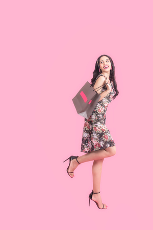 Summer Fashion smiling Women in Trendy spring and fashion working women for work day, pink background and pastel tone.  Lifestyle and Summer Fashion Foto de archivo