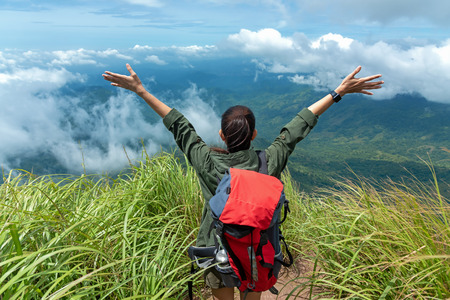 Hiker woman happy feeling freedom good and strong weight victorious facing on the natural mountain. Travel Concept