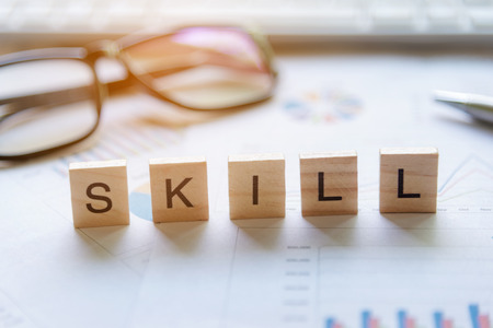 Words of business Skill concepts collected in crossword with wooden cubes. Business Concept