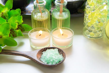 Thai Spa Treatments aroma therapy  salt and nature green sugar scrub and stone massage with green orchid flower on wooden white with candle. Thailand.  Healthy Concept. copy space,select and soft focus Banco de Imagens - 120819371