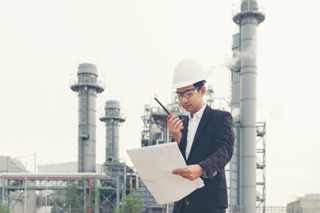 Asian man work experience and professional occupational engineer electrician with safety control at power plant energy industry and construction. Engineer Concept Banco de Imagens - 120819413