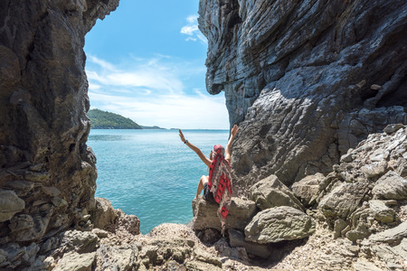 Travel people lifestyle women tourist standing and relax in summertime and vacations in a cave near the sea in Keo Sichang, Thailand. Travel and Trips Concept Banco de Imagens - 120819658