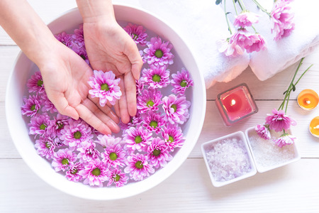 Spa treatment and product for female feet and manicure nails spa with pink flower for relax and healthy care. Therapy and Aroma for body women. Healthy Concept