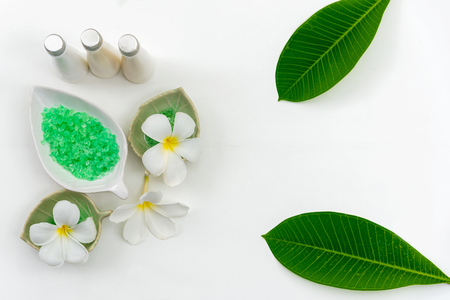 Thai spa composition treatments aroma therapy with candles and Plumeria flowers on white wooden table. Healthy Concept Banco de Imagens - 122837966