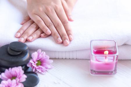 Spa treatment and product for female feet and manicure nails spa with candlelight and pink flower for relax and rest.  Healthy Concept. Banco de Imagens - 122837968