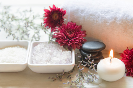 Thai Spa Treatments aroma therapy salt and sugar scrub and rock massage with red flower with candle. Thailand. Healthy Concept