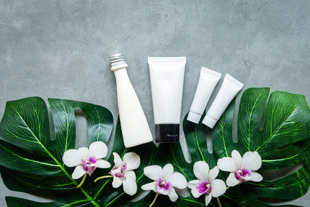 Spa cosmetic products organic green concept, spa beautiful massage on concrete background top view and copy space for text, Thai Spa relax and treatment for body healthy. Banco de Imagens