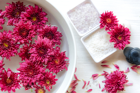 Thai Spa Treatments aroma therapy salt and sugar scrub and rock massage with red flower with candle for relax time. Thailand. Healthy Concept.