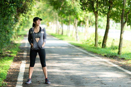 Running woman. Sport Women standing before jogging during outdoor Workout in a Park. Weight Loss and Healthy Concept