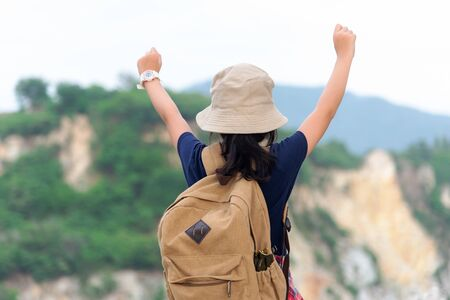 Hiker girl children happy feeling freedom good and strong weight victorious facing on the natural mountain. Travel Concept
