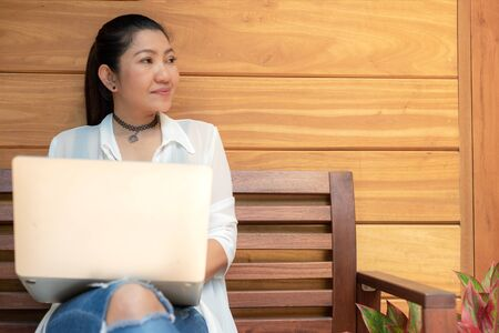 Lifestyle women freelance enjoy working laptop outdoors work space in the coffee shop for working .  Lifestyle Concept.