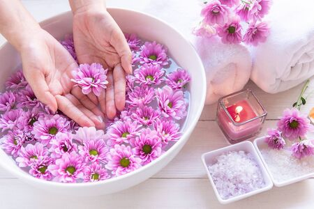 Spa treatment and product for female feet and manicure nails spa with pink flower and rock stone, copy space, select focus, Thailand. Healthy Concept Banco de Imagens