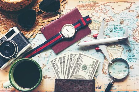 Budget and Saving money for Vacation. Traveler accessories and items man with black for planning travel vacations on the world. Travel and Saving concept