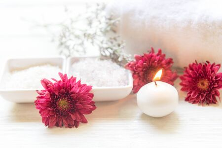 Aromatherapy Spa with candle and red flower spa and rolled towel. Thai Spa relax Treatments and massage white background, select focus.  Healthy Concept. Banco de Imagens