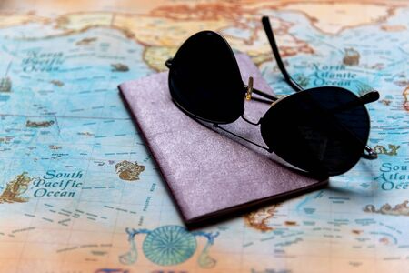 Top view of Traveler accessories and items man with backpack and visiting for planning travel vacations on the world, copy space.  Travel and Summer holiday concept