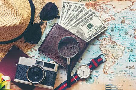 Top view of Traveler accessories and items man with black for planning travel vacations on the world, copy space. Travel and Summer holiday concept Banco de Imagens