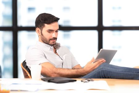 Relax time.  Successful Businessman relaxing  and resting after sitting and hard working in modern office. Healthy care for time. Business Concept Banco de Imagens