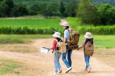 Group asian family children walking in the jungle adventure camping. Student tourism traveling destination leisure trips for education and relax in nature park.  Travel vacations and Life Concept Banco de Imagens