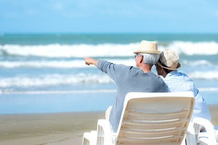 Lifestyle asian senior couple happy and relax on the beach. Tourism elderly family travel leisure and activity after retirement in vacations and summer.