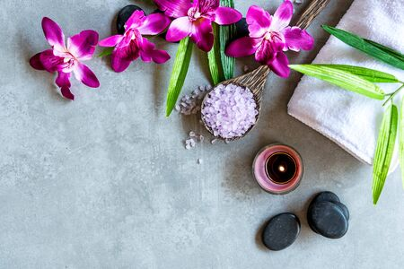 Thai Spa. Top view of hot stones setting for massage treatment and relax with purple orchid on blackboard with copy space.  Lifestyle Healthy Concept 写真素材